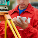 Engineer writing notes during construction inspection.
