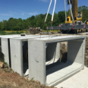 Concrete box culvert sections at construction site.