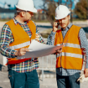 Resident Project Representative meets with contractor on construction site.